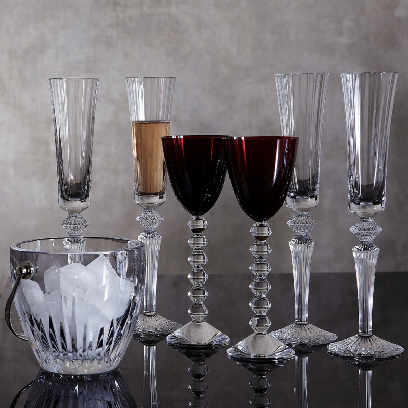 MILLE NUITS FLUTISSIMO. The Baccarat clear crystal FLUTISSIMO is designed by MATHIAS as part of Baccarat's MILLE NUITS collection. VEGA RHINE wine glases, MASSENA ice bucket